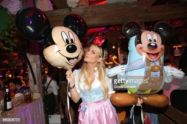 Jennifer Knaeble with Mickey Mouse balloon during the 'Disney Wies'n' as part of the Oktoberfest at Theresienwiese on September 20 2017 in Munich...