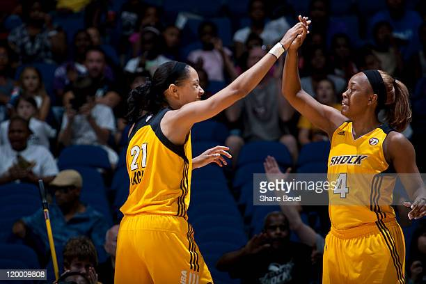 Jennifer Lacy and Amber Holt of the Tulsa Shock celebrate taking a three point lead during the WNBA game on July 28 2011 at the BOK Center in Tulsa...
