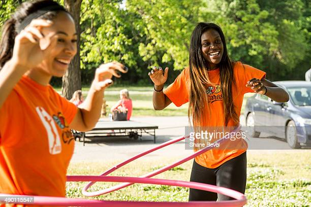 Jennifer Lacy and Tiffany Jackson Jones of the Tulsa Shock hula hoop with girls from the community during the WNBA Cares event at on May 8 2014 at...