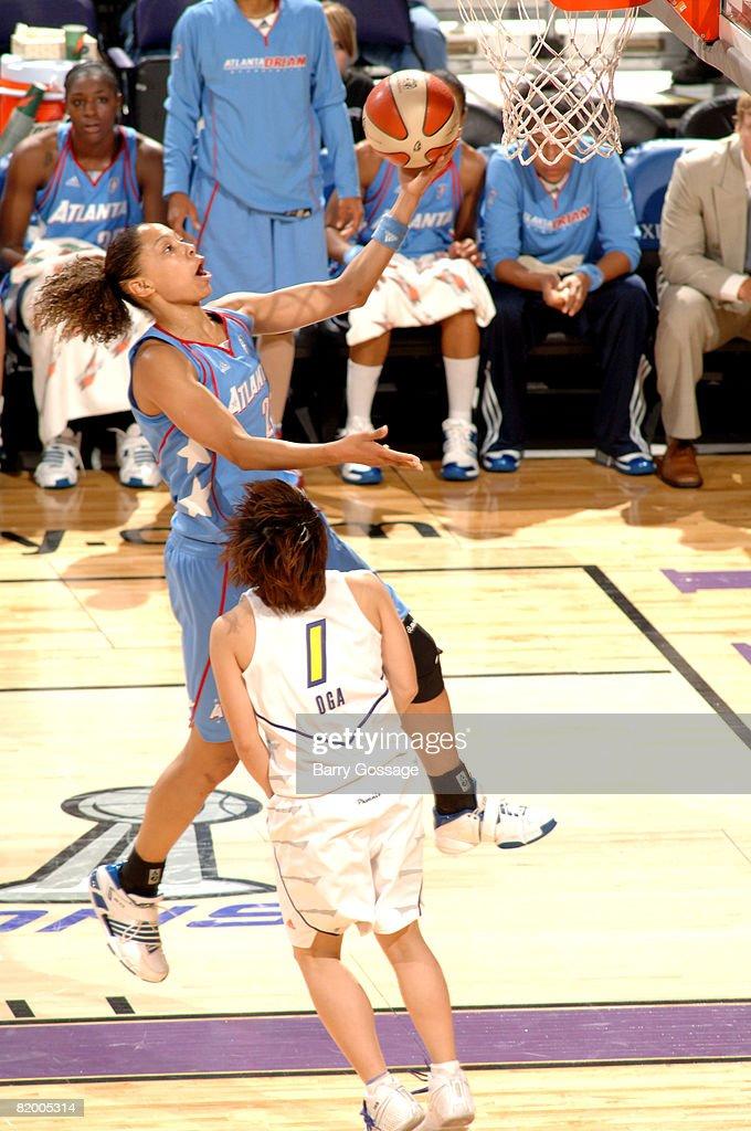 Jennifer Lacy of the Atlanta Dream shoots against Yuko Oga of the Phoenix Mercury on July 19 at US Airways Center in Phoenix Arizona NOTE TO USER...