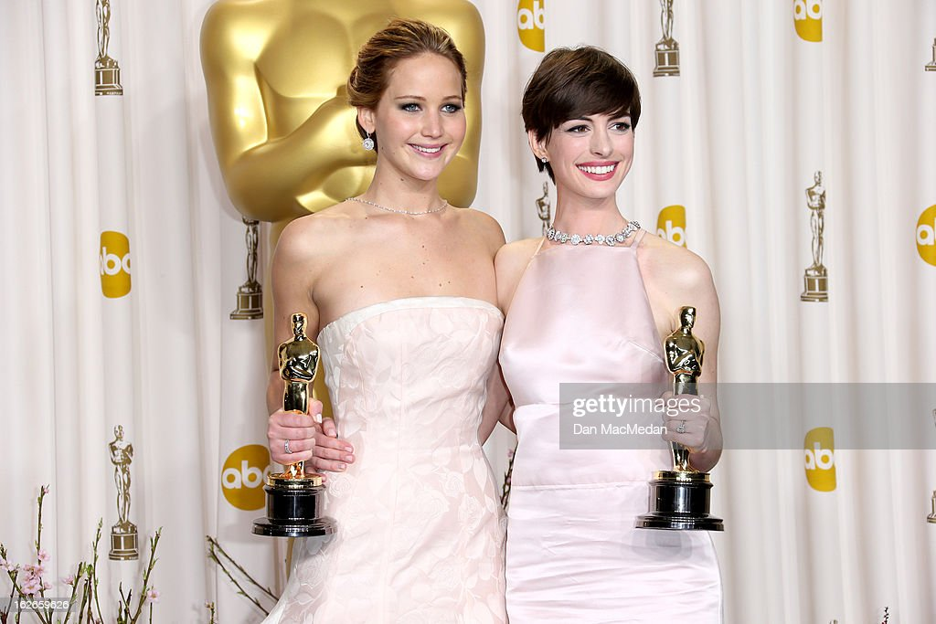 Jennifer Lawrence and Anne Hathaway pose in the press room at the 85th Annual Academy Awards at Hollywood & Highland Center on February 24, 2013 in Hollywood, California.