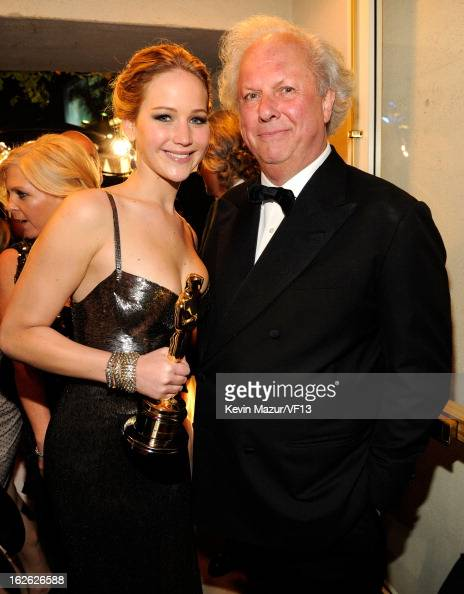 Jennifer Lawrence and Editorinchief of Vanity Fair Graydon Carter attends the 2013 Vanity Fair Oscar Party hosted by Graydon Carter at Sunset Tower...