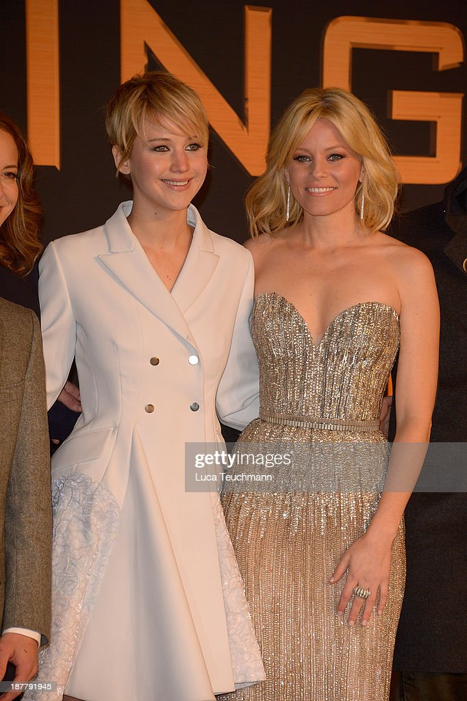 Jennifer Lawrence and Elizabeth Banks attends the German premiere of the film 'The Hunger Games - Catching Fire' (Tribute von Panem - Catching Fire) at Sony Centre on November 12, 2013 in Berlin, Germany.