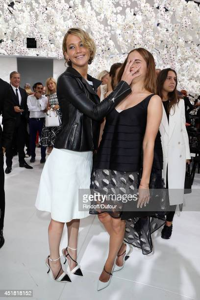 Jennifer Lawrence and Emma Watson attend the Christian Dior show as part of Paris Fashion Week Haute Couture Fall/Winter 20142015 at Muse Rodin on...