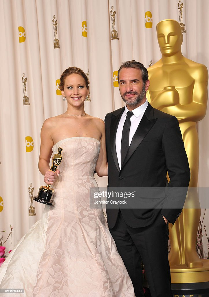 Jennifer Lawrence and Jean Dujardin arrive to the 85th Annual Academy Awards Press Room held at Hollywood & Highland Center on February 24, 2013 in Hollywood, California.