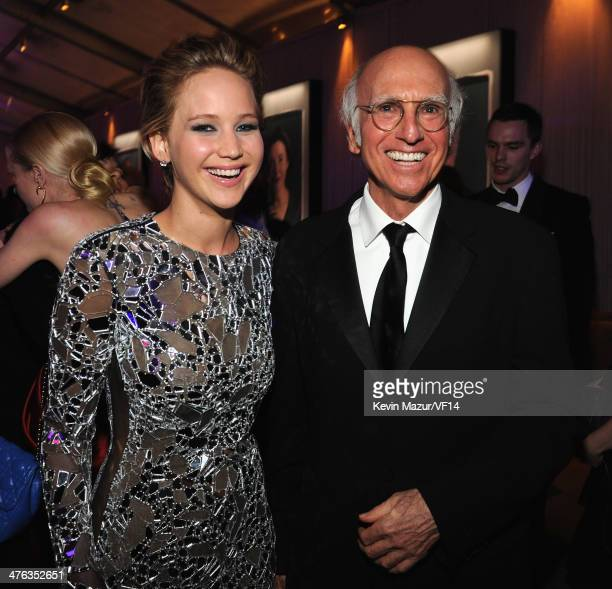 Jennifer Lawrence and Larry David attend the 2014 Vanity Fair Oscar Party Hosted By Graydon Carter on March 2 2014 in West Hollywood California