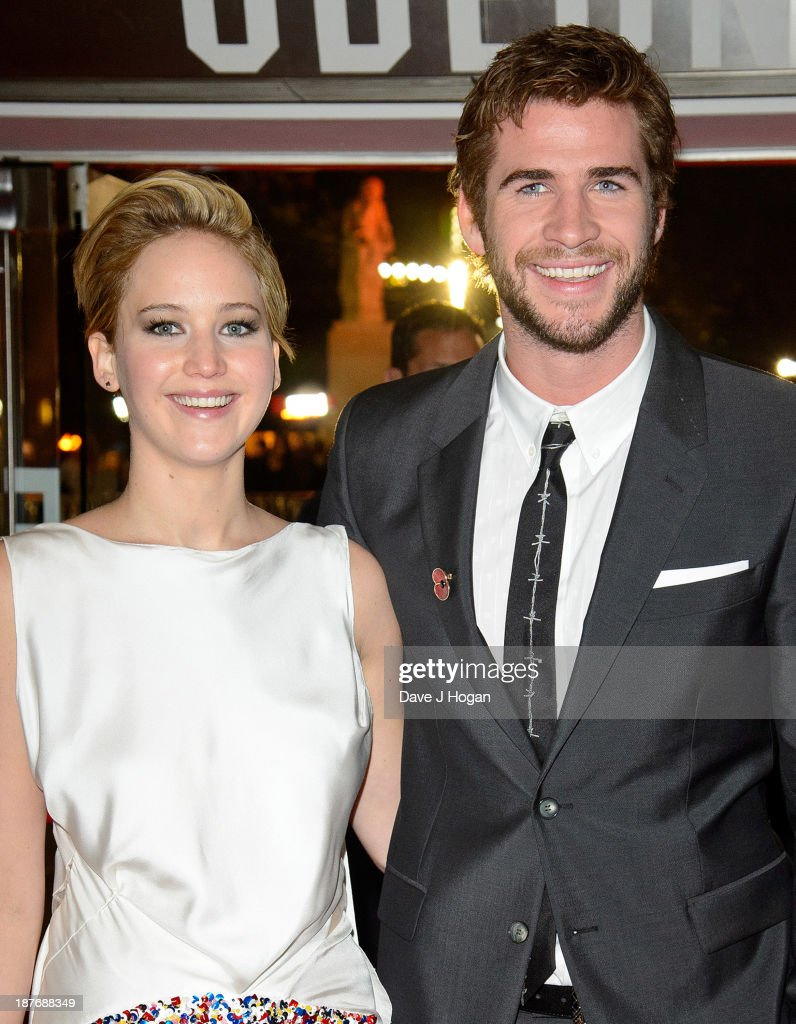 Jennifer Lawrence and Liam Hemsworth attend the UK Premiere of 'The Hunger Games: Catching Fire' at Odeon Leicester Square on November 11, 2013 in London, England.