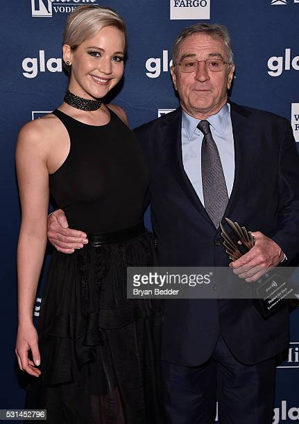 Jennifer Lawrence and Robert De Niro pose with an award at the 27th Annual GLAAD Media Awards in New York on May 14 2016 in New York City