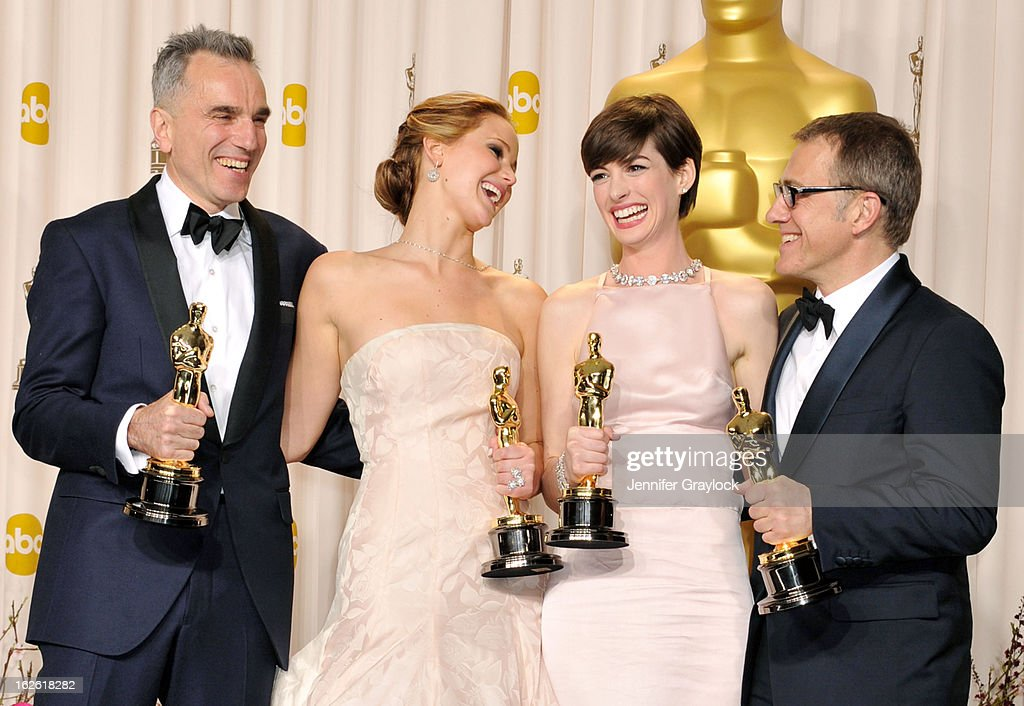 Jennifer Lawrence, Anne Hathaway, Daniel Day-Lewis and Christoph Waltz in the press room during the 85th Annual Academy Awards held at the Loews Hollywood Hotel on February 24, 2013 in Hollywood, California.