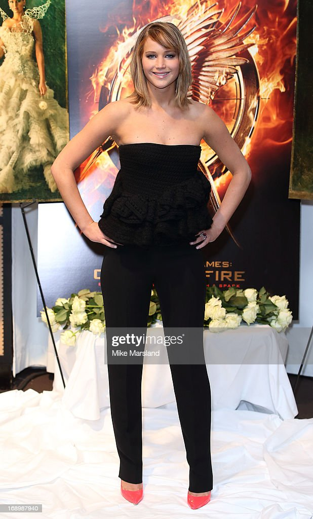<a gi-track='captionPersonalityLinkClicked' href=/galleries/search?phrase=Jennifer+Lawrence&family=editorial&specificpeople=1596040 ng-click='$event.stopPropagation()'>Jennifer Lawrence</a> attends the photocall for 'The Hunger Games: Catching Fire' at The 66th Annual Cannes Film Festival at Majestic Hotel on May 18, 2013 in Cannes, France.