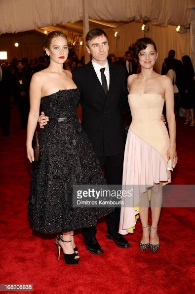 Jennifer Lawrence designer Raf Simons and Marion Cotillard attend the Costume Institute Gala for the 'PUNK Chaos to Couture' exhibition at the...