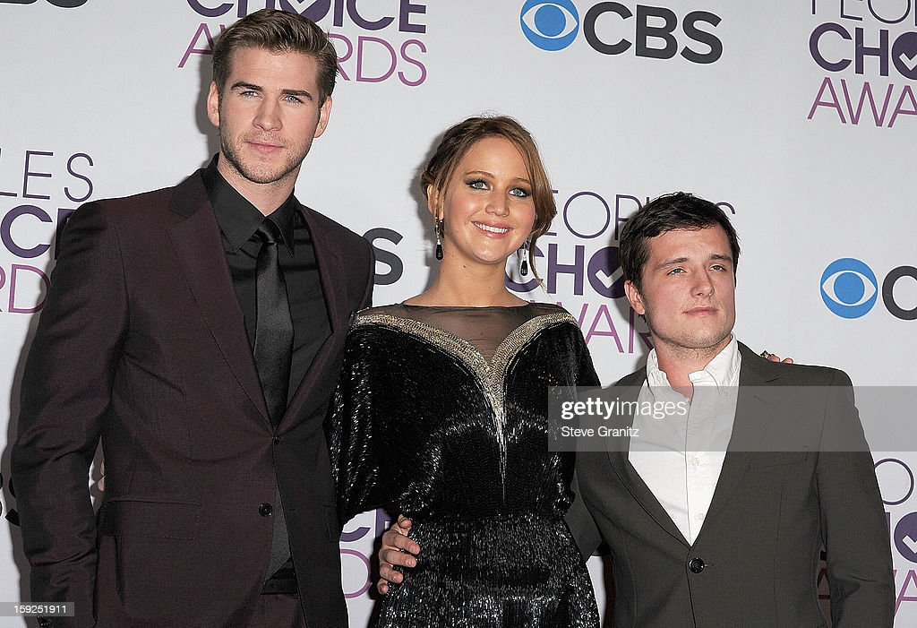 Jennifer Lawrence ,Josh Hutcherson and Liam Hemsworth poses at the 2013 People's Choice Awards at Nokia Theatre L.A. Live on January 9, 2013 in Los Angeles, California.