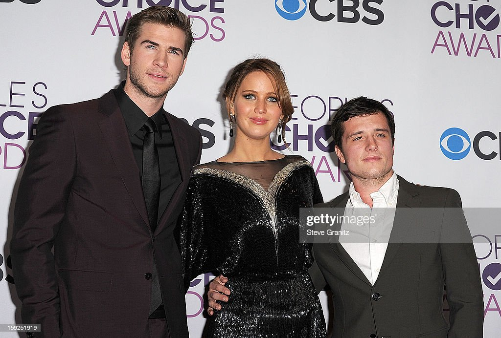 Jennifer Lawrence, Josh Hutcherson and Liam Hemsworth poses at the 2013 People's Choice Awards at Nokia Theatre L.A. Live on January 9, 2013 in Los Angeles, California.
