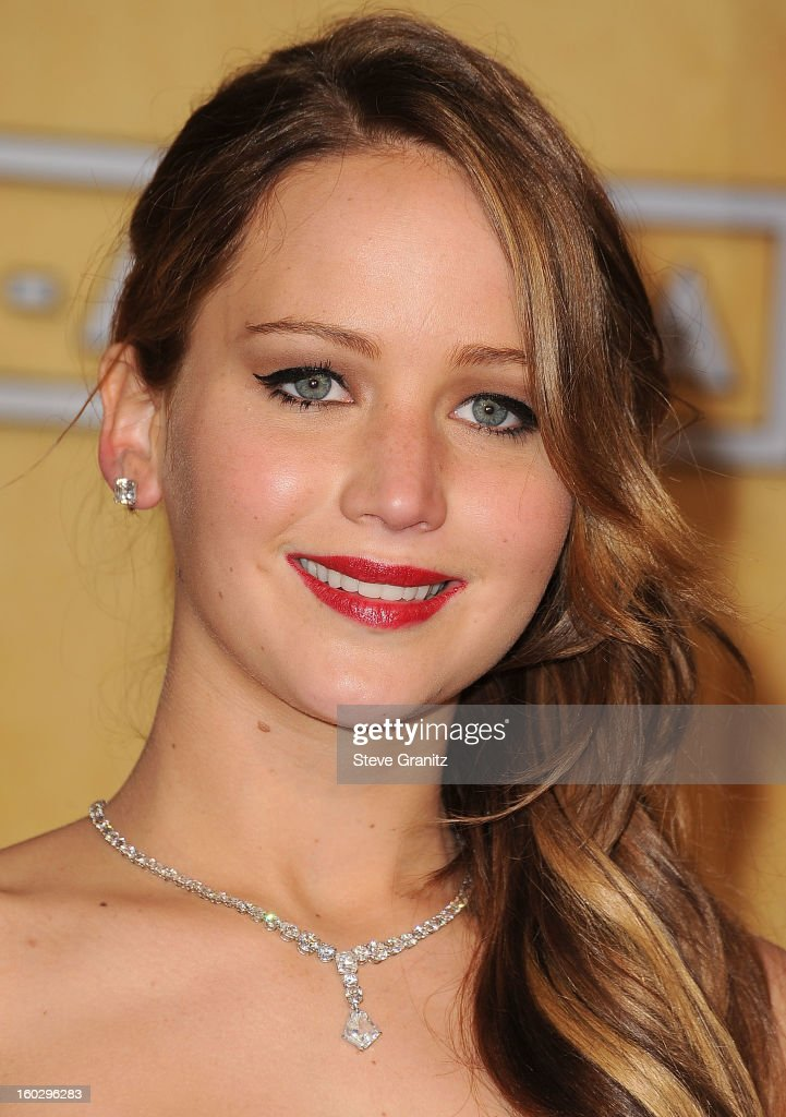 Jennifer Lawrence pose at the 19th Annual Screen Actors Guild Awards at The Shrine Auditorium on January 27, 2013 in Los Angeles, California.