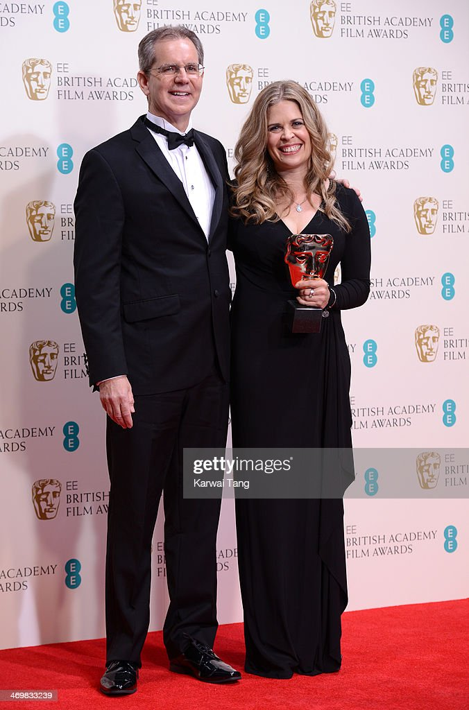 Jennifer Lee and Chris Buck winner of the Best Animated Film award pose in the winners room at the EE British Academy Film Awards 2014 at The Royal...
