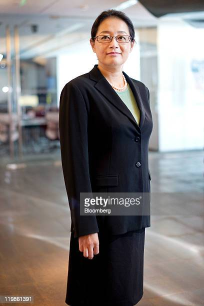 Jennifer Li chief financial officer of Baidu Inc poses for a portrait in Beijing China on Tuesday July 26 2011 Baidu Inc will use cash generated from...