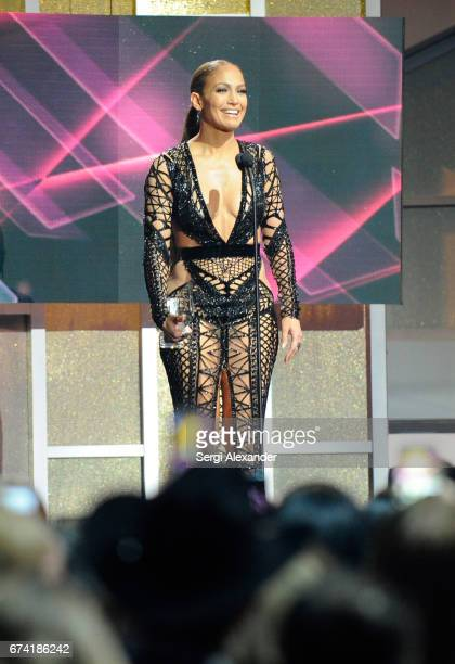 Jennifer Lopez accepts an award onstage at the Billboard Latin Music Awards at Watsco Center on April 27 2017 in Coral Gables Florida