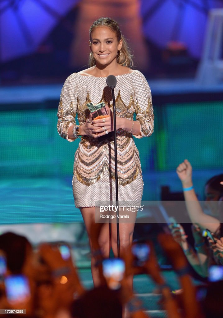 Jennifer Lopez accepts an award onstage during the Premios Juventud 2013 at Bank United Center on July 18, 2013 in Miami, Florida.
