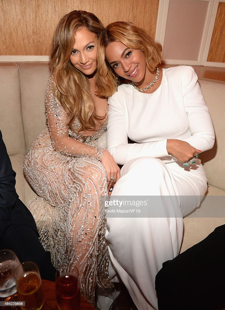 Jennifer Lopez and Beyonce attend the 2015 Vanity Fair Oscar Party hosted by Graydon Carter at the Wallis Annenberg Center for the Performing Arts on...