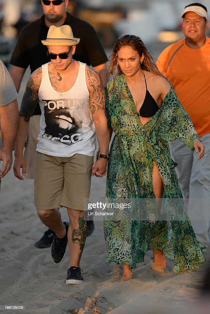 Jennifer Lopez and Casper Smart are sighted after gun shots are fired near their location as they film a commercial on the beach on May 5, 2013 in Fort Lauderdale, Florida.