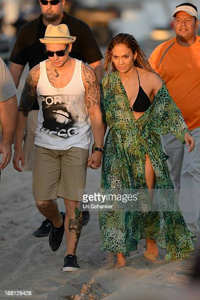 Jennifer Lopez and Casper Smart are sighted after gun shots are fired near their location as they film a commercial on the beach on May 5 2013 in...