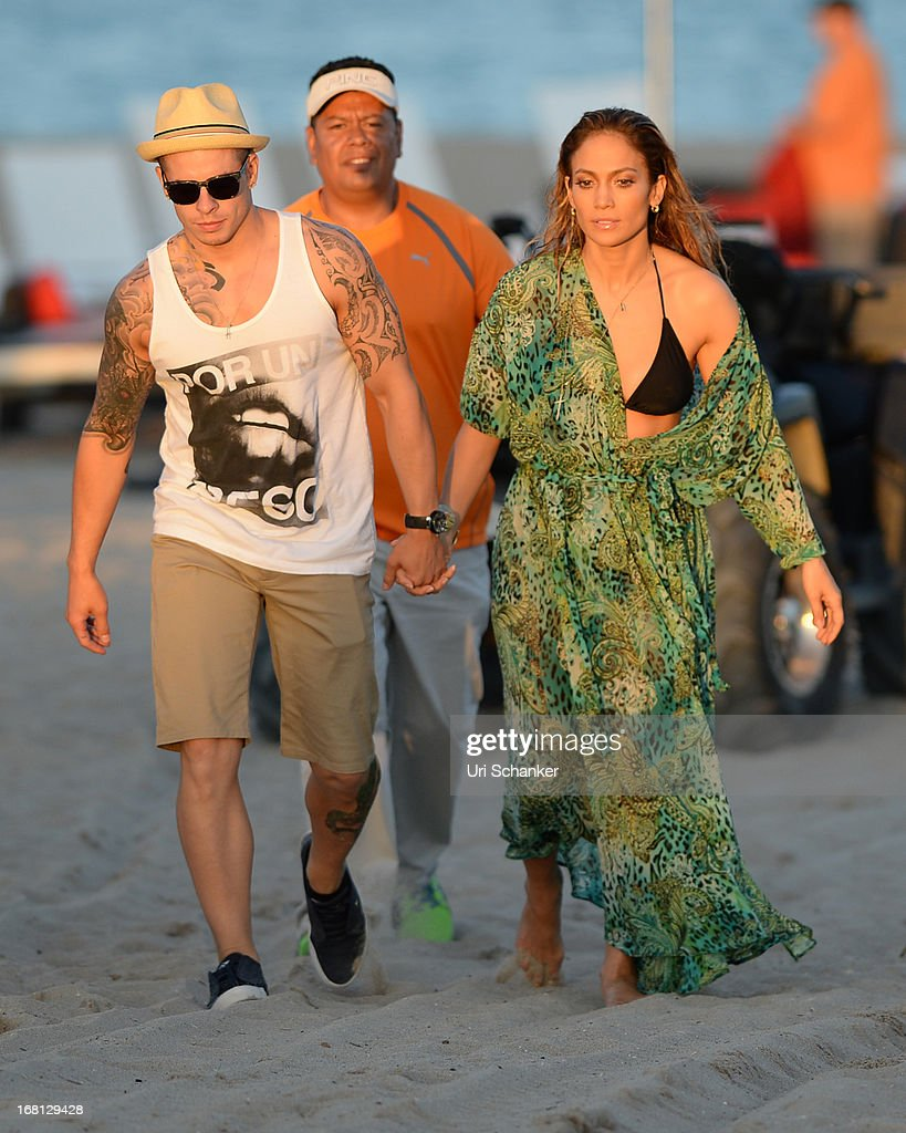 <a gi-track='captionPersonalityLinkClicked' href=/galleries/search?phrase=Jennifer+Lopez&family=editorial&specificpeople=201784 ng-click='$event.stopPropagation()'>Jennifer Lopez</a> and <a gi-track='captionPersonalityLinkClicked' href=/galleries/search?phrase=Casper+Smart&family=editorial&specificpeople=7596672 ng-click='$event.stopPropagation()'>Casper Smart</a> are sighted after gun shots are fired near their location as they film a commercial on the beach on May 5, 2013 in Fort Lauderdale, Florida.