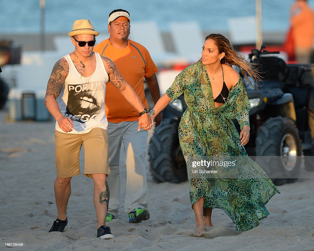 Jennifer Lopez and Casper Smart are sighted after gun shots are fired as they film a commercial on the beach on May 5, 2013 in Fort Lauderdale, Florida.