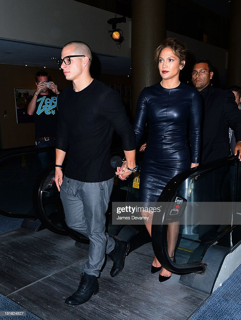 <a gi-track='captionPersonalityLinkClicked' href=/galleries/search?phrase=Jennifer+Lopez&family=editorial&specificpeople=201784 ng-click='$event.stopPropagation()'>Jennifer Lopez</a> and Casper Smart (L) arrive to Marquis Theatre for Broadway play Evita on September 11, 2012 in New York City.
