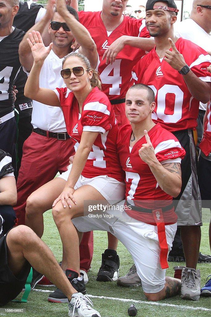 Jennifer Lopez and Casper Smart attend the Pre-Concert Celebrity Football Game Benefiting Hurricane Sandy Relief at Hiram Bithorn Stadium on December 22, 2012 in San Juan, Puerto Rico.