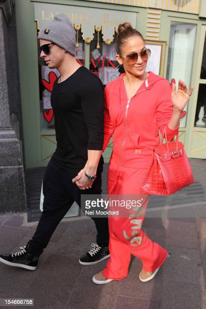Jennifer Lopez and Casper Smart seen leaving the Ladurée shop at Harrods on October 24 2012 in London England