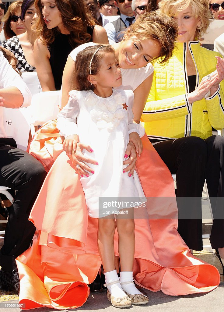 <a gi-track='captionPersonalityLinkClicked' href=/galleries/search?phrase=Jennifer+Lopez&family=editorial&specificpeople=201784 ng-click='$event.stopPropagation()'>Jennifer Lopez</a> and daughter Emme Marbiel Muniz at <a gi-track='captionPersonalityLinkClicked' href=/galleries/search?phrase=Jennifer+Lopez&family=editorial&specificpeople=201784 ng-click='$event.stopPropagation()'>Jennifer Lopez</a> Honored With Star On The Hollywood Walk Of Fame on June 20, 2013 in Hollywood, California.