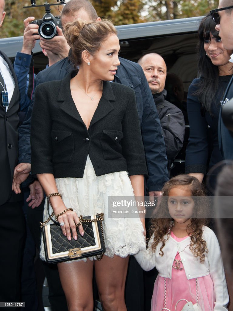 <a gi-track='captionPersonalityLinkClicked' href=/galleries/search?phrase=Jennifer+Lopez&family=editorial&specificpeople=201784 ng-click='$event.stopPropagation()'>Jennifer Lopez</a> and her daughter Emme Maribel Muniz arrive at the Chanel Spring / Summer 2013 show as part of Paris Fashion Week at Grand Palais on October 2, 2012 in Paris, France.