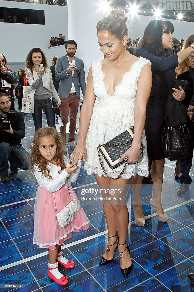 <a gi-track='captionPersonalityLinkClicked' href=/galleries/search?phrase=Jennifer+Lopez&family=editorial&specificpeople=201784 ng-click='$event.stopPropagation()'>Jennifer Lopez</a> (R) and her daughter Emme Maribel Muniz attend the Chanel Spring / Summer 2013 show as part of Paris Fashion Week at Grand Palais on October 2, 2012 in Paris, France.