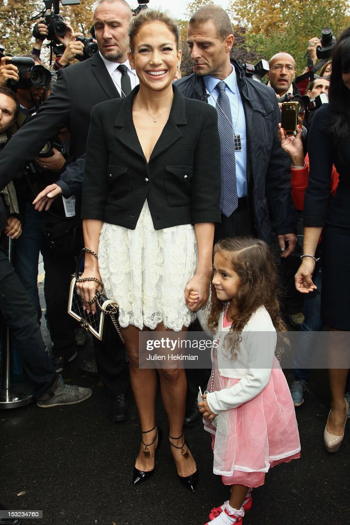 <a gi-track='captionPersonalityLinkClicked' href=/galleries/search?phrase=Jennifer+Lopez&family=editorial&specificpeople=201784 ng-click='$event.stopPropagation()'>Jennifer Lopez</a> and her daughter Emme Maribel Muniz leave the Chanel Spring / Summer 2013 show as part of Paris Fashion Week at Grand Palais on October 2, 2012 in Paris, France.