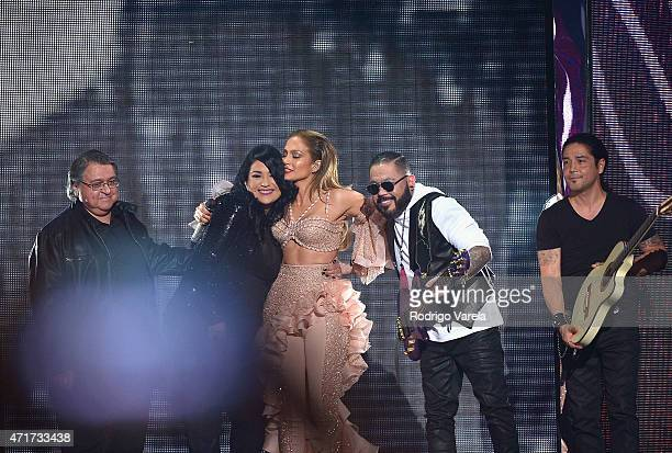 Jennifer Lopez and Los Dinos onstage after performing musical tribute to Selena at the 2015 Billboard Latin Music Awards presented bu State Farm on...