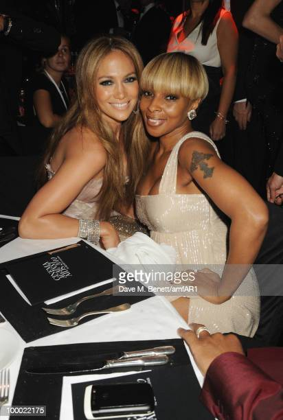 Jennifer Lopez and Mary J Blige attend amfAR's Cinema Against AIDS 2010 benefit gala dinner at the Hotel du Cap on May 20 2010 in Antibes France