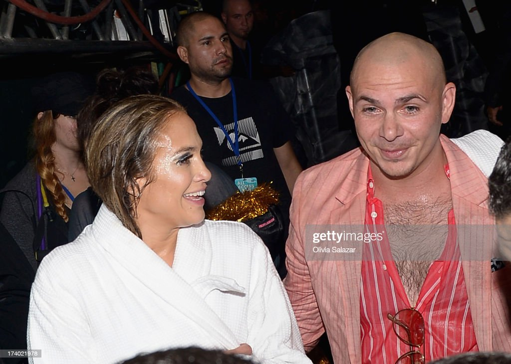 Jennifer Lopez and Pitbull is seen backstage during the at Premios Juventud 2013 at Bank United Center on July 18, 2013 in Miami, Florida.