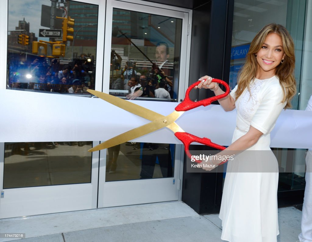 <a gi-track='captionPersonalityLinkClicked' href=/galleries/search?phrase=Jennifer+Lopez&family=editorial&specificpeople=201784 ng-click='$event.stopPropagation()'>Jennifer Lopez</a> cuts the ribbon at the opening of Viva Movil By <a gi-track='captionPersonalityLinkClicked' href=/galleries/search?phrase=Jennifer+Lopez&family=editorial&specificpeople=201784 ng-click='$event.stopPropagation()'>Jennifer Lopez</a> flagship store on July 26, 2013 in New York City.