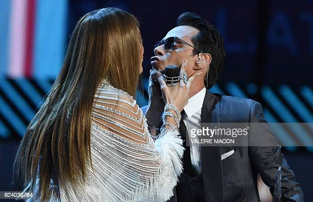 Jennifer Lopez kisses Marc Anthony during the show of the 17th Annual Latin Grammy Awards on November 17 in Las Vegas Nevada / AFP / Valerie MACON
