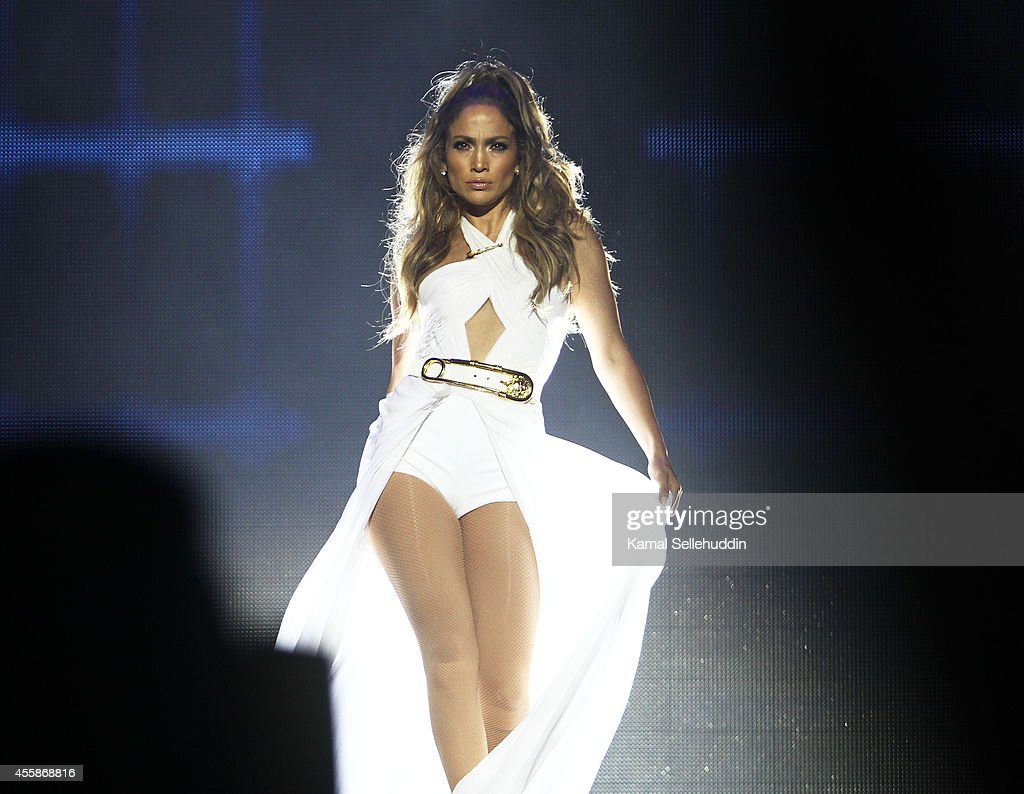 <a gi-track='captionPersonalityLinkClicked' href=/galleries/search?phrase=Jennifer+Lopez&family=editorial&specificpeople=201784 ng-click='$event.stopPropagation()'>Jennifer Lopez</a> performs live following the Singapore F1 Grand Prix 2014 on September 21, 2014 in Singapore, Singapore.