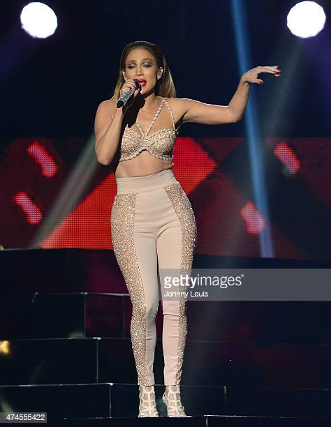 Jennifer Lopez performs musical tribute to Selena while performing with Los Dinos onstage at the 2015 Billboard Latin Music Awards presented by State...