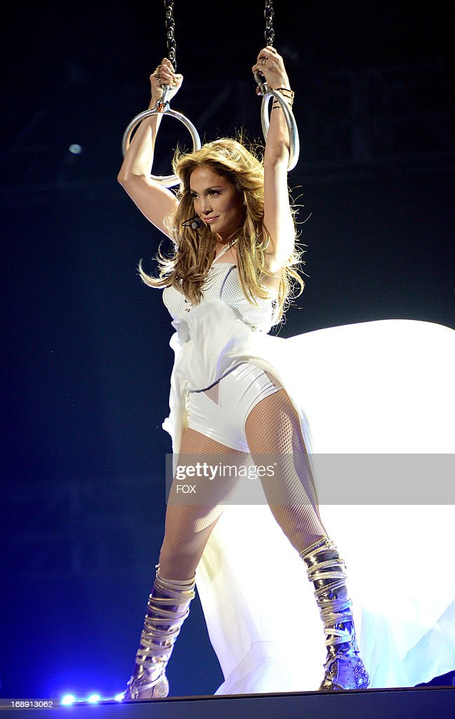 <a gi-track='captionPersonalityLinkClicked' href=/galleries/search?phrase=Jennifer+Lopez&family=editorial&specificpeople=201784 ng-click='$event.stopPropagation()'>Jennifer Lopez</a> performs onstage at FOX's 'American Idol' Season 12 Live Finale Show at Nokia Theatre L.A. Live on May 16, 2013 in Los Angeles, California.