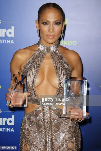 Jennifer Lopez poses with awards in the press room during the Billboard Latin Music Awards at Watsco Center on April 27 2017 in Coral Gables Florida