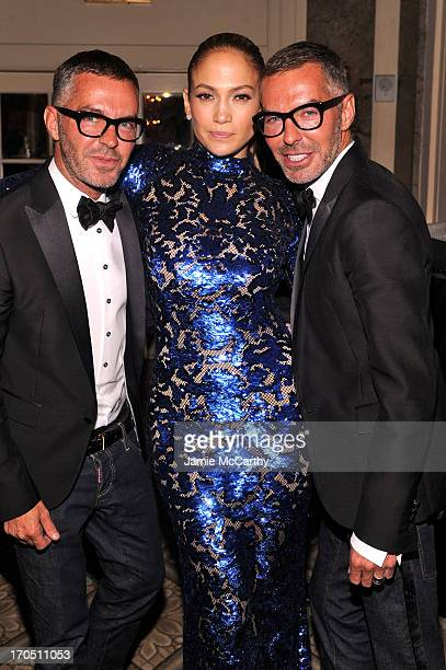 Jennifer Lopez poses with Dean Caten and Dan Caten of Dsquared2 at the 4th Annual amfAR Inspiration Gala New York at The Plaza Hotel on June 13 2013...