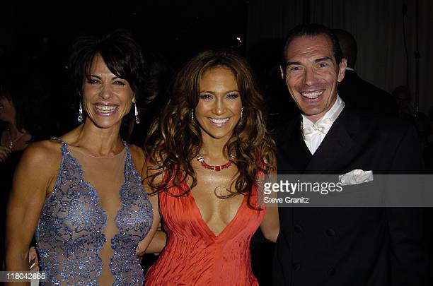 Jennifer Lopez poses with gala producer Giselle FernandezFarrand and MGM Chairman and CEO Alex Yemenidjian in Beverly Hills Calif on Saturday Oct 2...