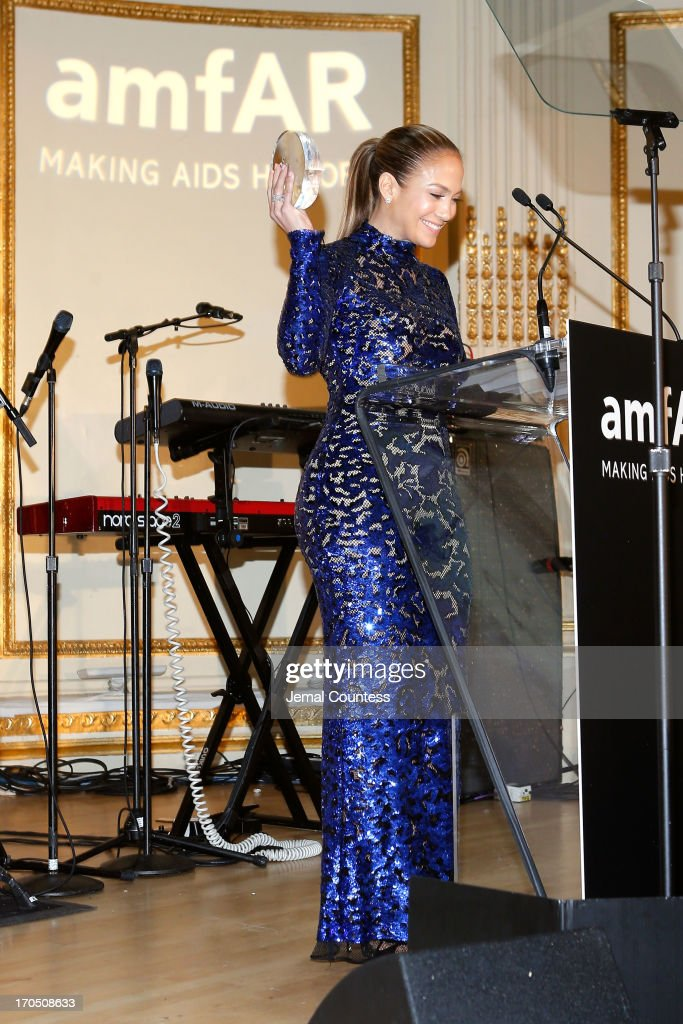 <a gi-track='captionPersonalityLinkClicked' href=/galleries/search?phrase=Jennifer+Lopez&family=editorial&specificpeople=201784 ng-click='$event.stopPropagation()'>Jennifer Lopez</a> recipient of the Humanitarian award, speaks on stage at the 4th Annual amfAR Inspiration Gala New York at The Plaza Hotel on June 13, 2013 in New York City.