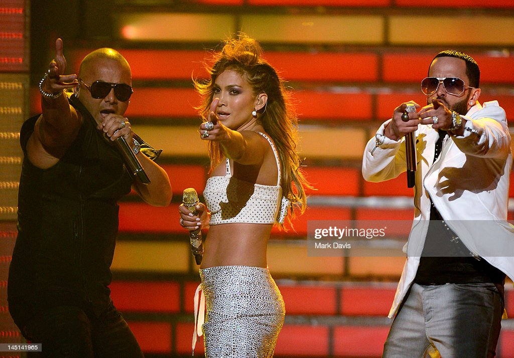 Jennifer Lopez with Wisin and Yandel of Wisin Y Yandel perform onstage during Fox's 'American Idol 2012' results show at Nokia Theatre LA Live on May...