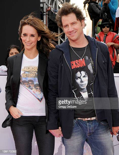 Jennifer Love Hewitt and Jamie Kennedy arrive at 'This Is It' Premiere at the Nokia Theater LA Live on October 27 2009 in Los Angeles California