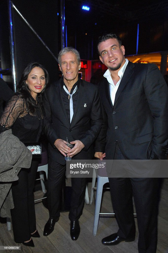 Jennifer Mir, singer Michael Bolton and UFC fighter Frank Mir appear at the HSN Live Michael Bolton concert at The Venetian Resort Hotel Casino on February 8, 2013 in Las Vegas, Nevada.