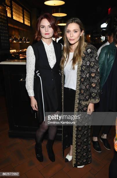 Jennifer Morrison and Elizabeth Olsen attend Through Her Lens The Tribeca Chanel Women's Filmmaker Program Luncheon at Locanda Verde on October 17...